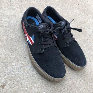 Nike Sb black suede brown bottom shoes.